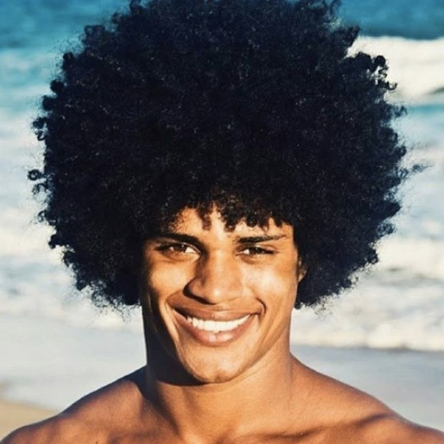 a-photograph-of-a-mulatto-male-with-a-huge-afro-hairstyle-done-on-his-epic-kinky-curly-hair